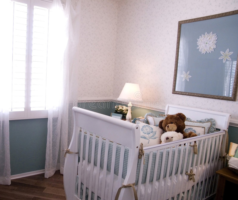 Baby's nursery. Beautiful baby's nursery interior design in new home royalty free stock photo