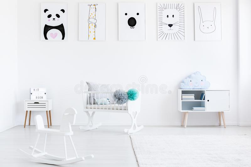 Baby`s room with rocking horse stock photos