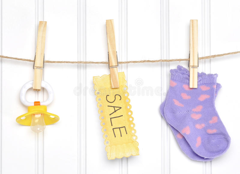 Download Baby Sale Goods On A Clothesline Stock Photo - Image: 24172334