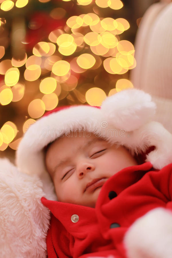 Baby santa. Baby boys very first Christmas royalty free stock image