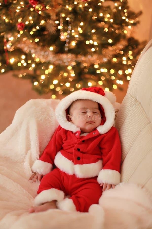 Baby santa. Baby boys very first Christmas royalty free stock photo