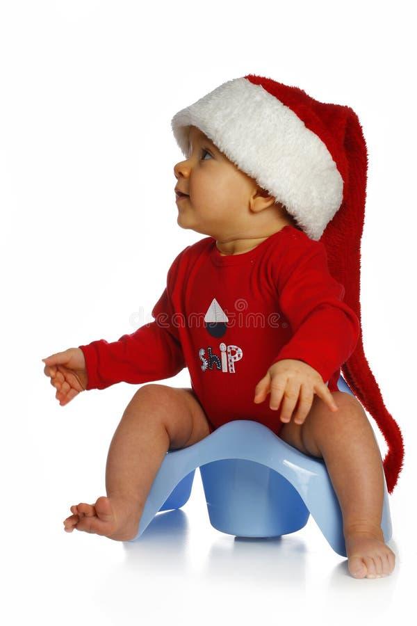 Baby in Santa Claus cap stock image