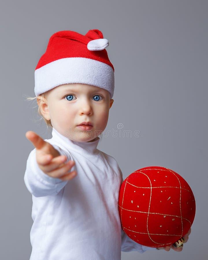 Baby in Santa hat New Year stock photos