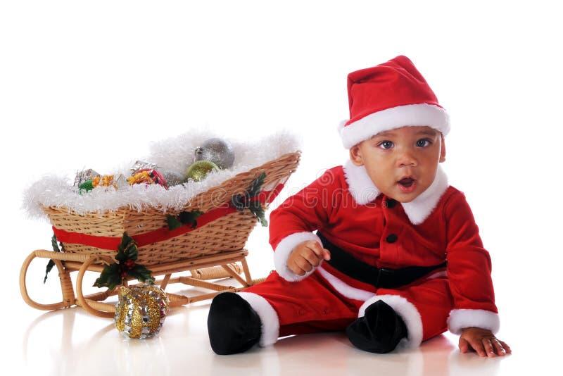 Baby Santa with Sleigh royalty free stock photo