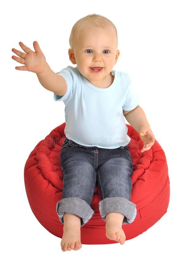 Baby say hallo. Baby on red chair is making hello royalty free stock image
