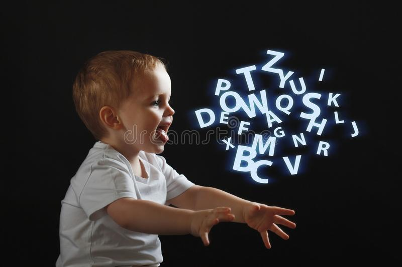 Baby says, the concept of problems with dyslexia and dysgraphia. A child learns to speak stock image