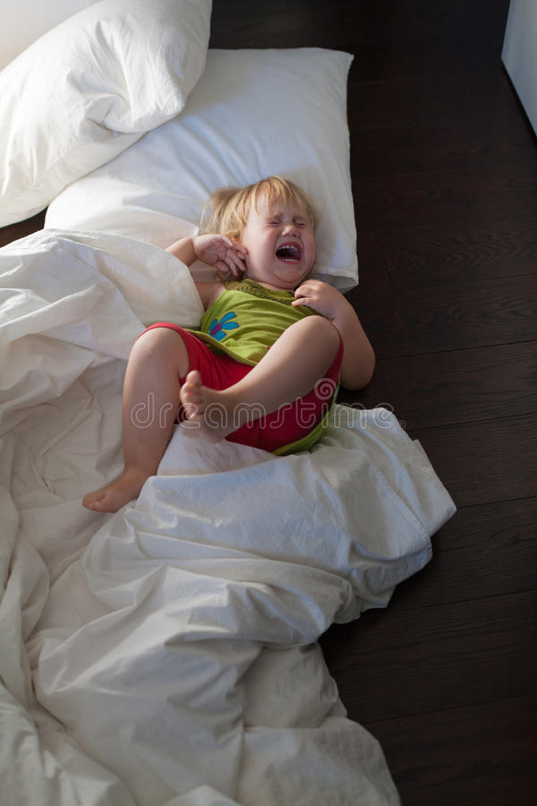 Girl 4 Years Old Screaming While Lying In Bed Stock Photo