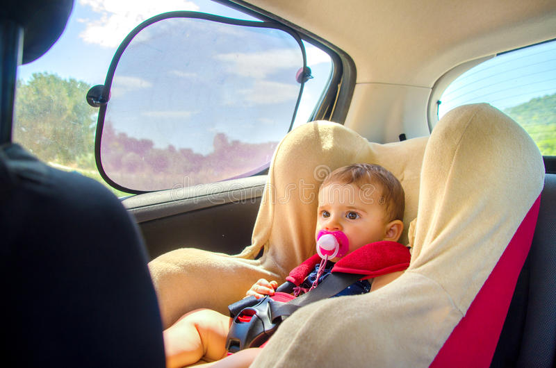 Baby seat car curtains. Newborn royalty free stock image