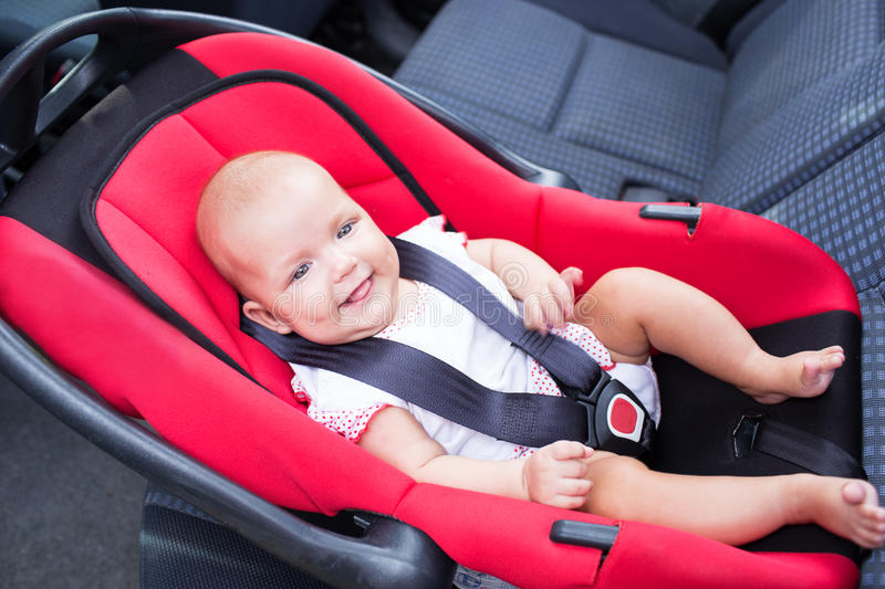 Baby seats in the car seat. Woman baby seats in the car seat stock photos