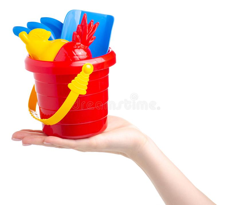 Baby set red sandbox bucket shovel rake toy in hand stock photos
