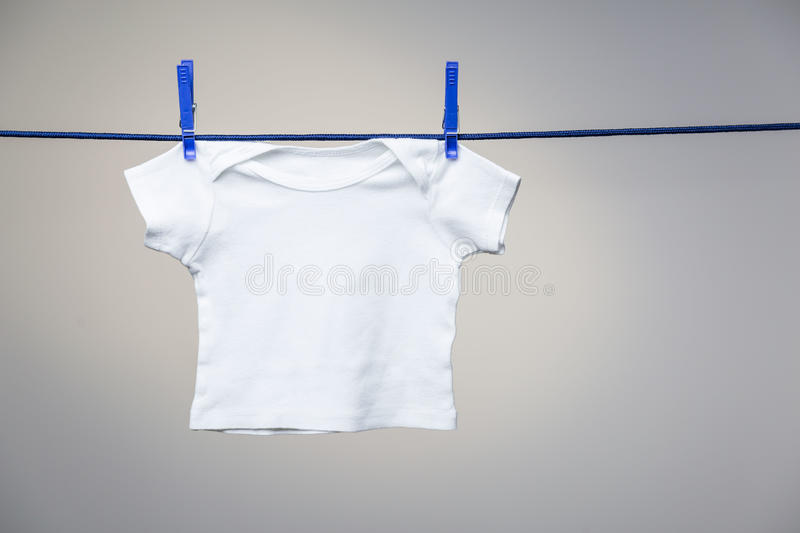 Baby shirt on clothesline royalty free stock image