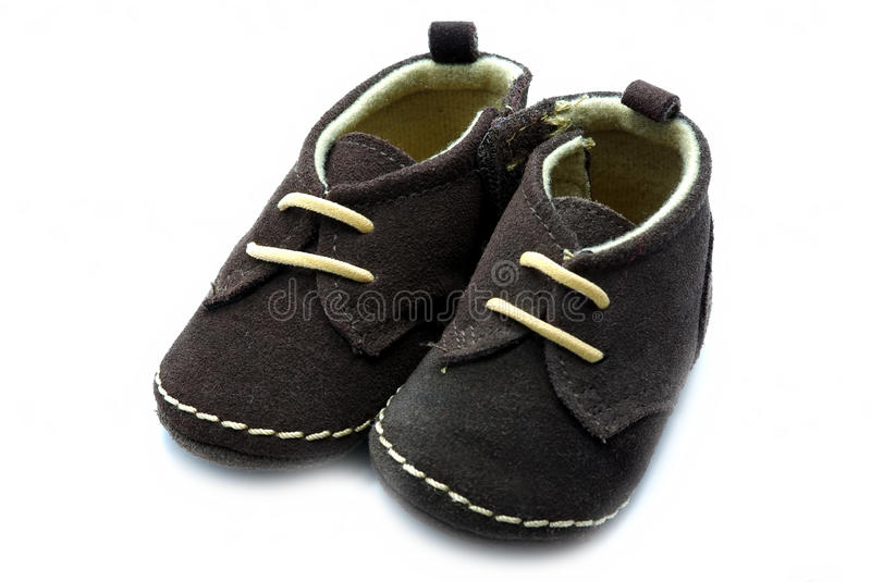 Baby shoe. A pair of baby shoe on white stock photography