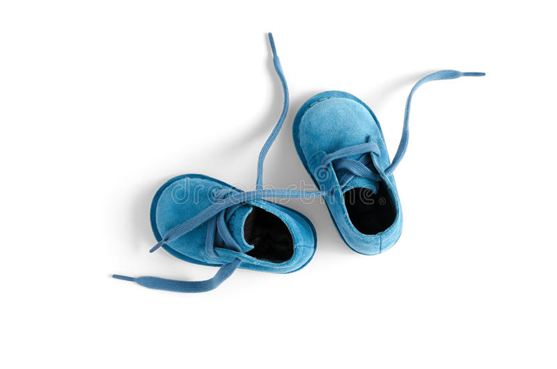 Baby Shoe. Blue baby shoe over white stock photography