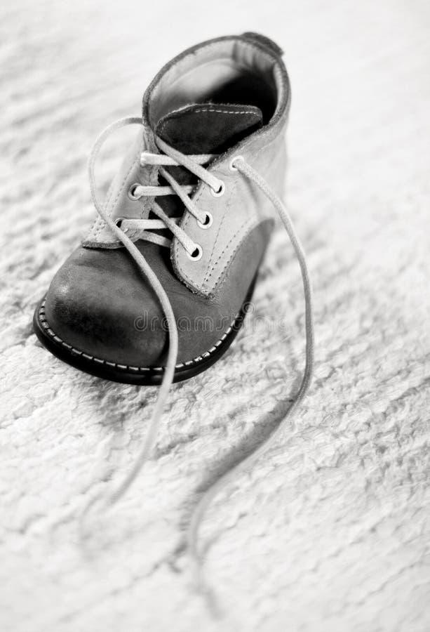 Baby shoe. A closeup of an old baby shoe stock photos