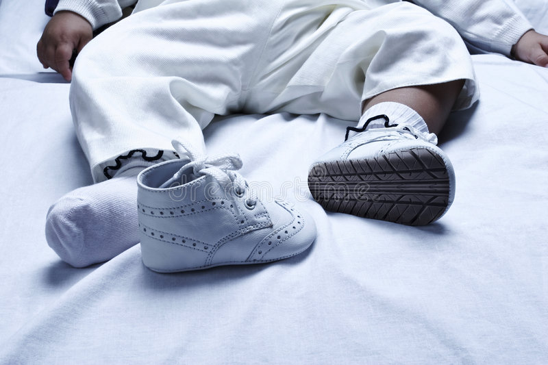 Baby shoe. A baby with modified shoe stock images