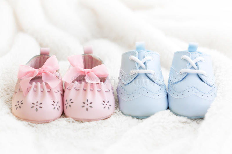 Baby shoes. For a boy and a girl royalty free stock image