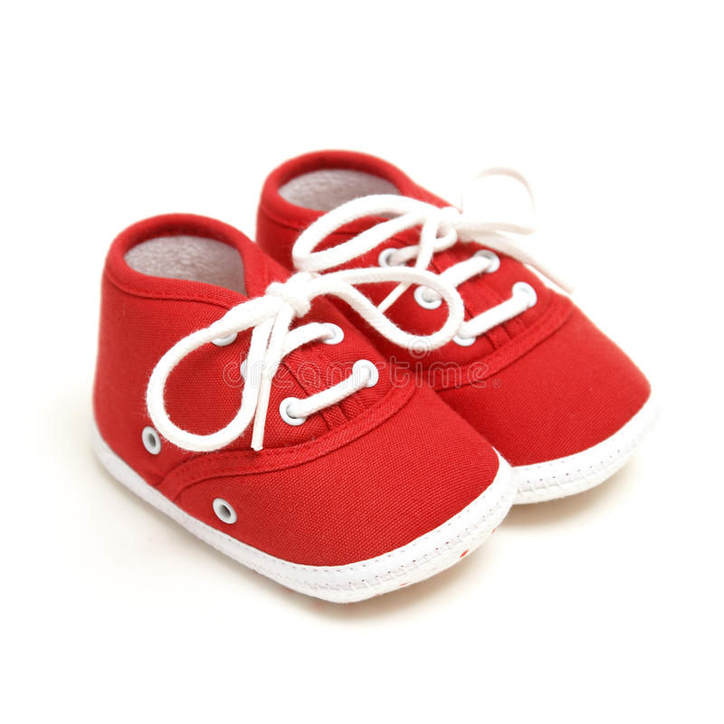 Baby Shoes. An isolated pair of red baby shoes for the newborn to wear royalty free stock photography