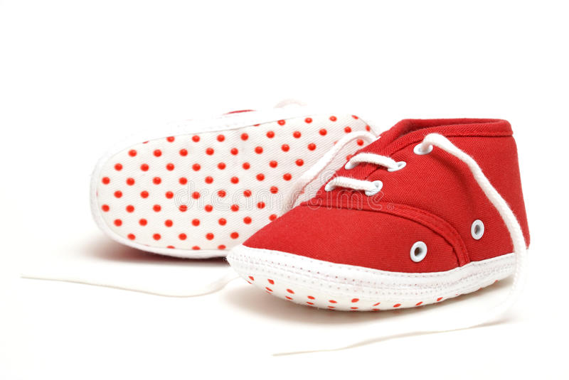 Baby Shoes. An isolated pair of red baby shoes for the newborn to wear royalty free stock photo