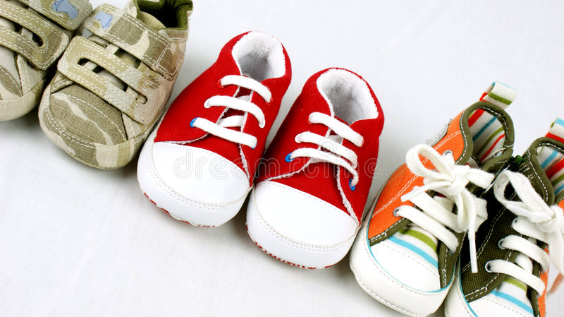 Baby shoes. Line up of baby shoes stock image