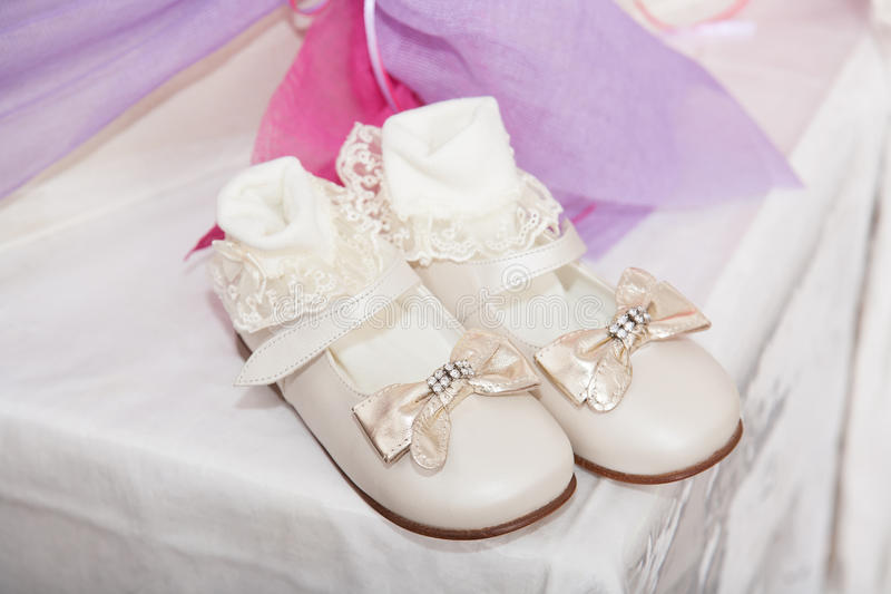 Baby shoes. Closeup of girl baby shoes royalty free stock photos
