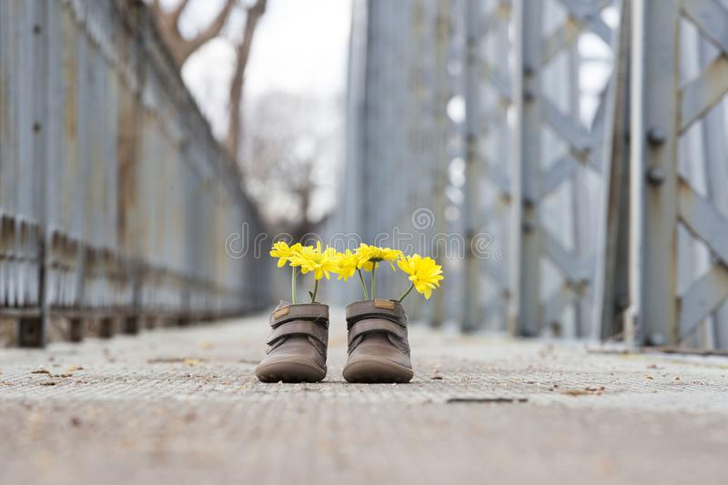Baby shoes with yellow flowers royalty free stock photo