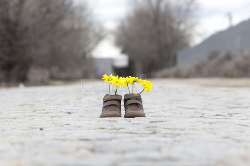 Baby shoes with yellow flowers stock images