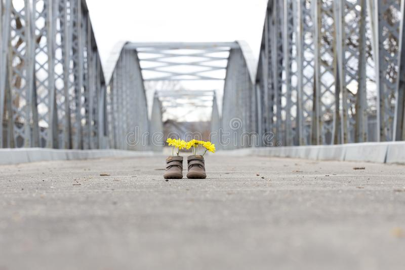 Baby shoes with yellow flowers stock photography