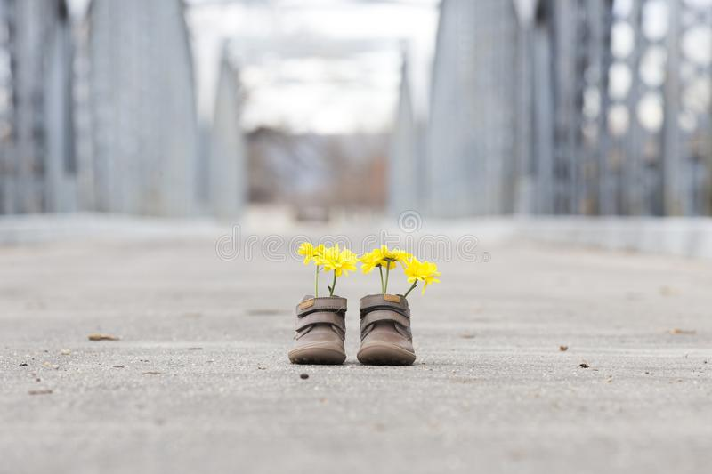 Baby shoes with yellow flowers stock image