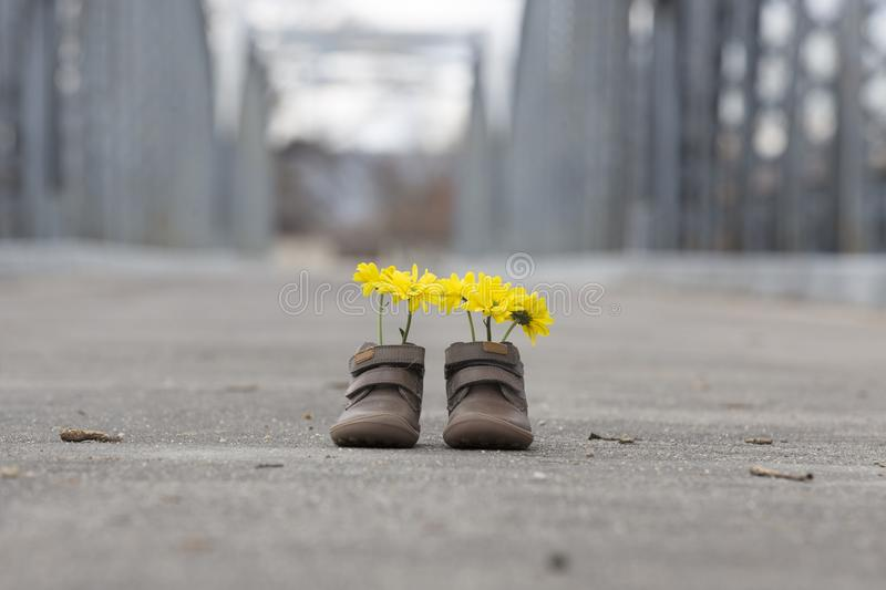 Baby shoes with yellow flowers stock photo