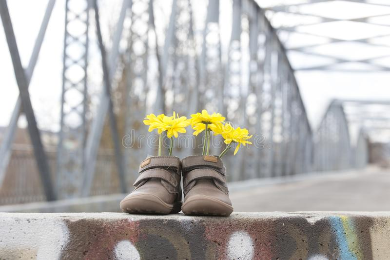 Baby shoes with yellow flowers royalty free stock image
