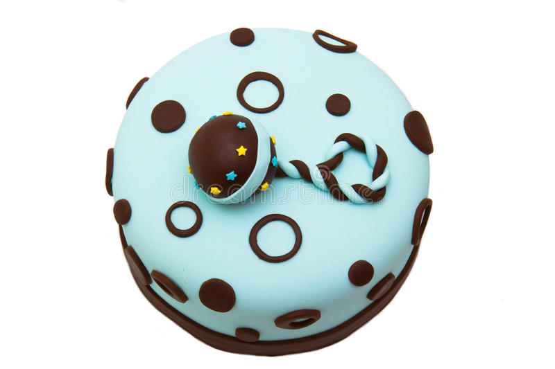 Baby shower cake. Baby shower fondant cake with a rattle on top royalty free stock photos