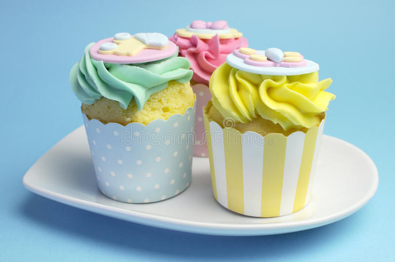 Baby shower or childrens pink, aqua & yellow cupcakes stock image