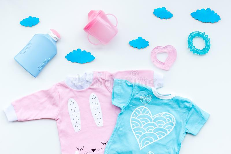 Download Baby Shower Concept. Baby`s Clothes And Accessories On Light  Background Top View