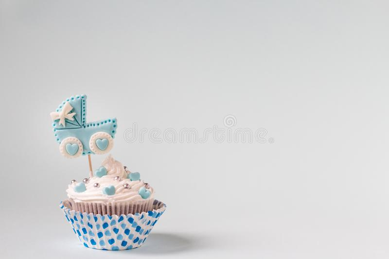 Baby shower cupcake for a boy. Newborn announcement concept. Text space. Baby shower cupcake. Welcome baby boy concept. Newborn announcement. Text space stock images