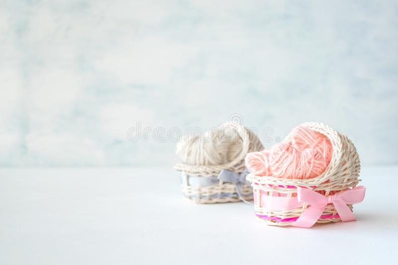 Baby shower ideas for a girl and boy party. Pink and blue decorative straw cradles with thread hearts and text BOY or GIRL. stock images