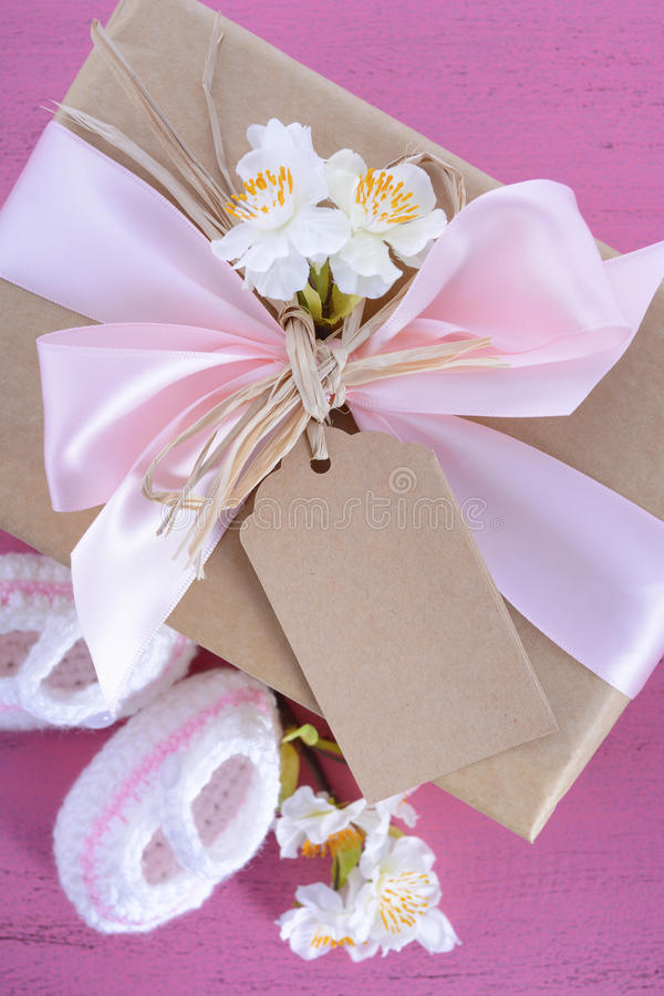 Baby shower Its a Girl natural wrap gift stock photos