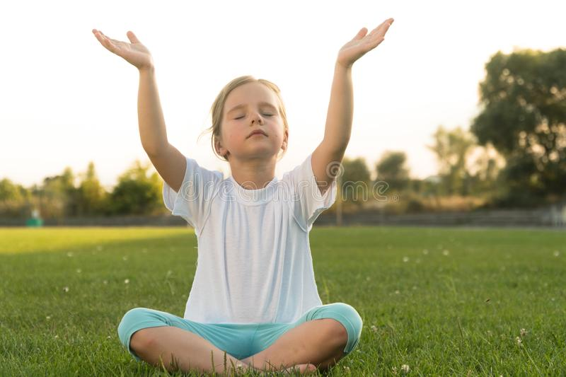 Baby Yoga Lotus Pose.. A Child Practicing Yoga Outdoors ...