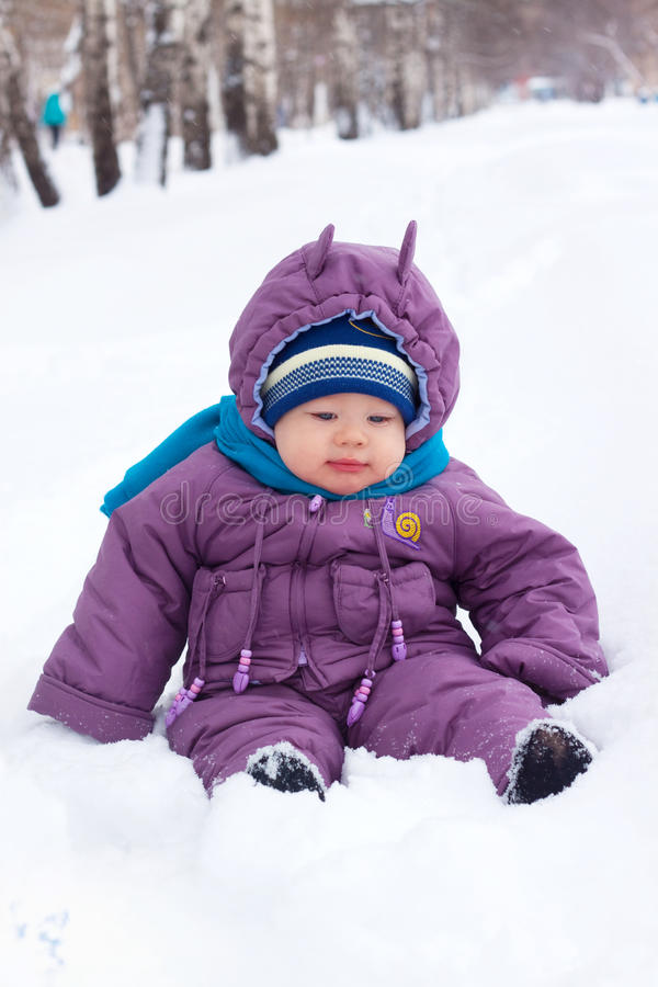 Download Baby  sits in the snow stock image. Image of cold, tenderness - 17252037