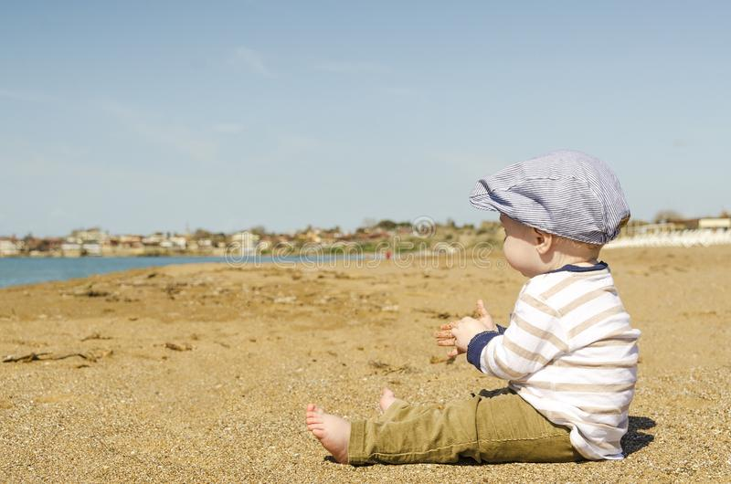 Baby Sitting In Brown Sand Free Public Domain Cc0 Image