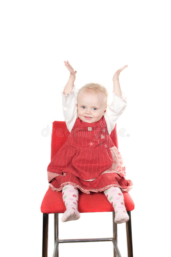 Baby sitting on the chair stock images