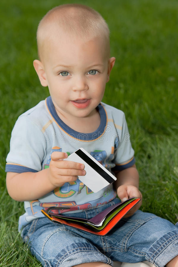Baby sitting on grass royalty free stock photos
