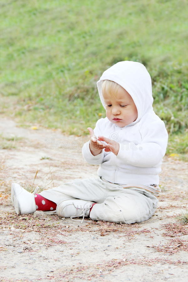 Download Baby Sitting on the Ground stock photo. Image of pave - 21585898
