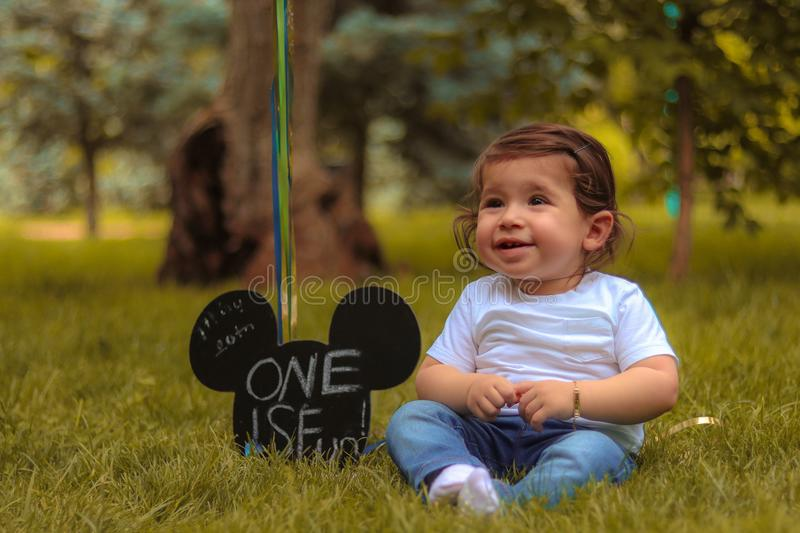 Baby Sitting on Lawn Grass royalty free stock image