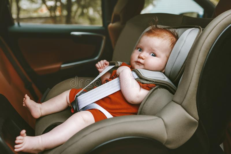 Baby sitting in safety rear-facing car seat. Family lifestyle vacation road trip child security transportation stock image