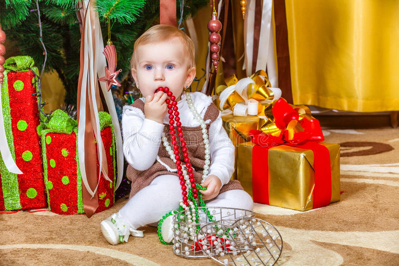 Download Baby Sitting Under Christmas Tree In Room Stock Photos - Image: 37527233