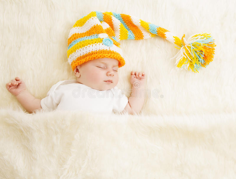 Baby Sleep in Hat, Sleeping Newborn Kid in Bed, Asleep New Born. Child stock photography