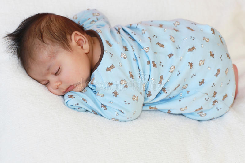 Baby sleeping. A 2 weeks old baby fast asleep stock images