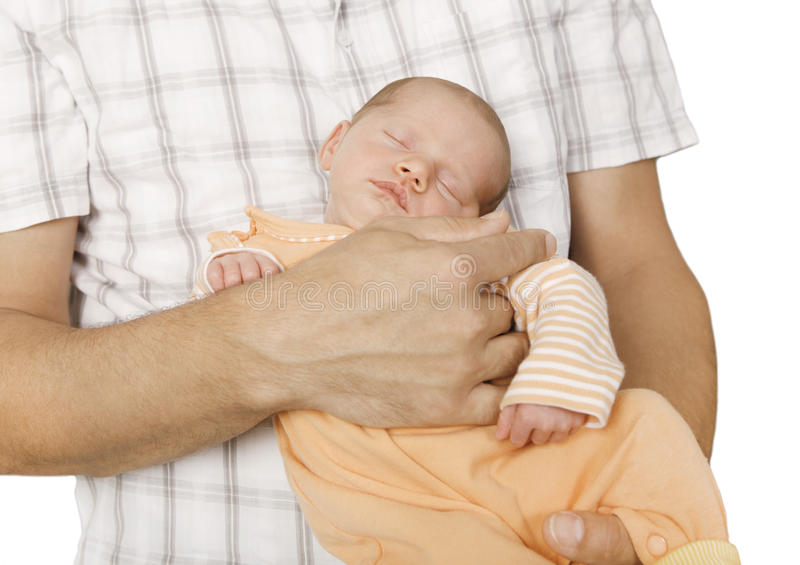 Baby sleeping on the arm. A sleeping baby lying on his father's arm, background white, isolated stock image