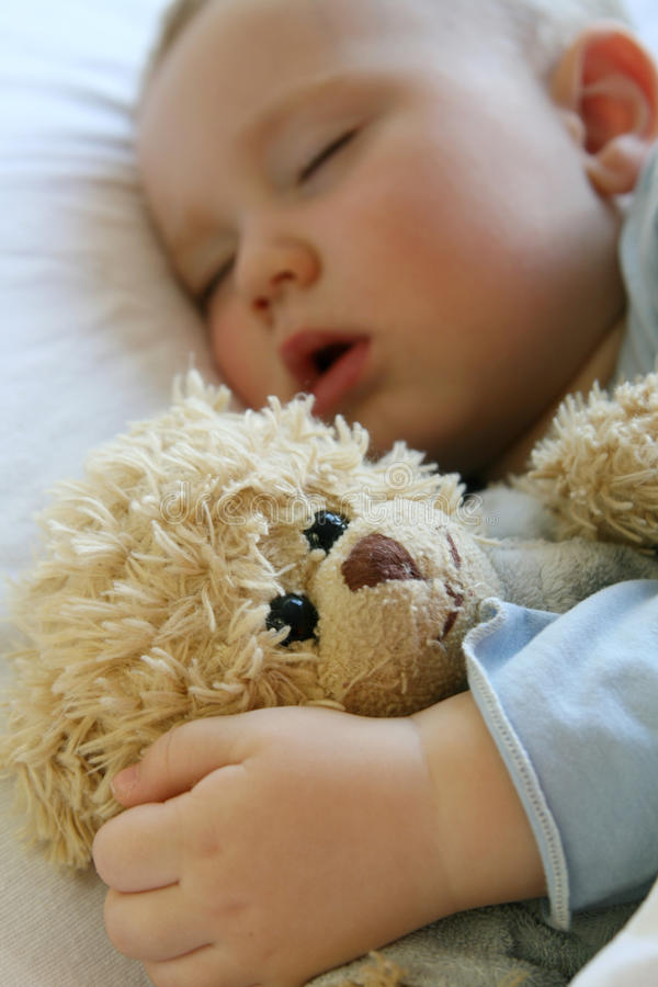 Baby Sleeping In Bed Royalty Free Stock Images
