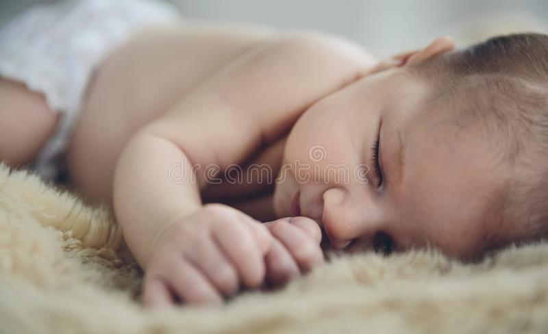Baby sleeping on a blanket royalty free stock images